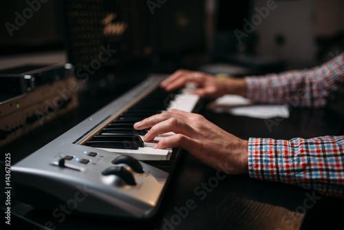 Fototapeta Male sound producer hands on musical keyboard obraz na płótnie