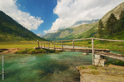 Photo Footbridge over the Chiese river and in the National Park of Adamello Brenta from the Val di Fumo