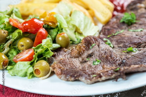 Papiers peints Steakhouse juicy steak beef meat with tomato and french fries