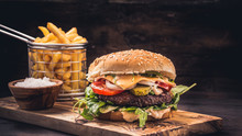 Burger With Fries On Wooden