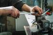 Mechanics repairing a diesel injector.