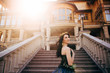 Beautiful woman in a luxurious blue dress with a long train