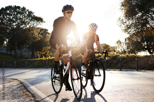 Fotografie, Obraz  Handsome bearded professional male cyclist riding his racing bicycle in the morn