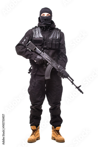 Fototapeta Terrorist holding a machine gun in his hands isolated over white