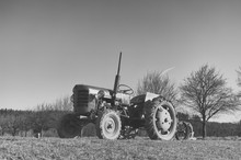 Old Small Tractor On The Field