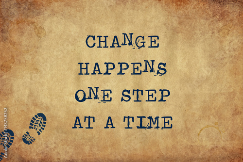 Inspiring motivation quote of change happens one step at a time with typewriter text Wallpaper Mural