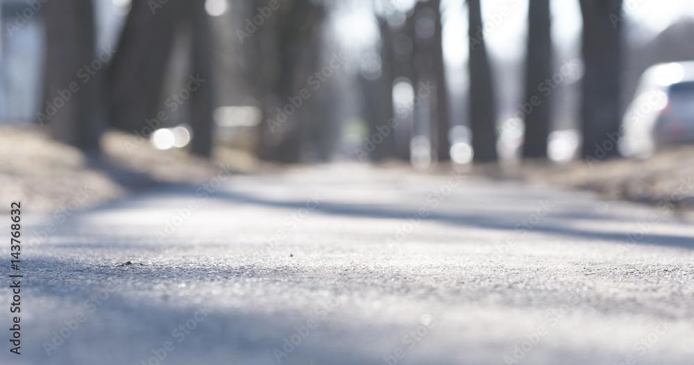 Fototapeta low angle shot of sidewalk in town in spring focus close to camera, 4k photo
