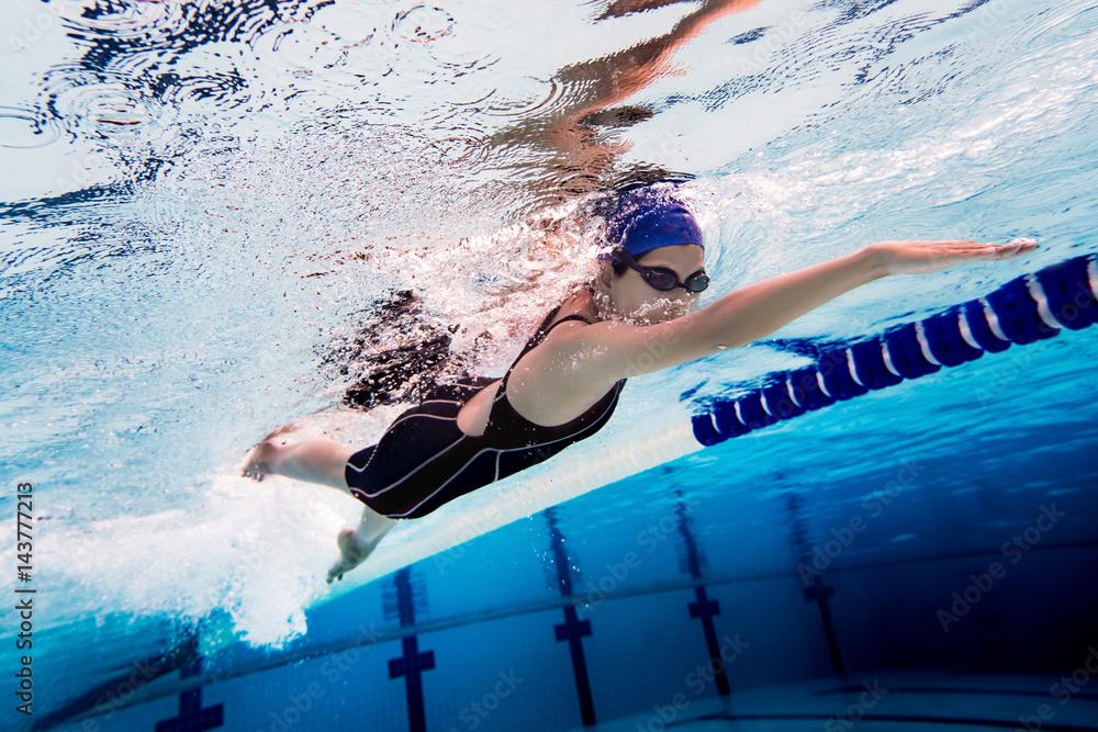Fototapety, obrazy: Woman swimming pool.Underwater photo