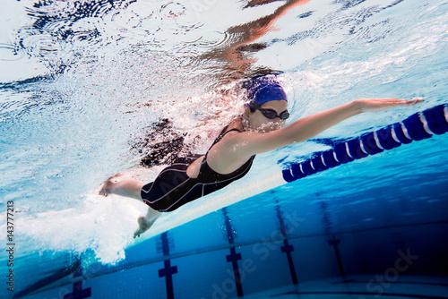 Photo  Woman swimming pool.Underwater photo