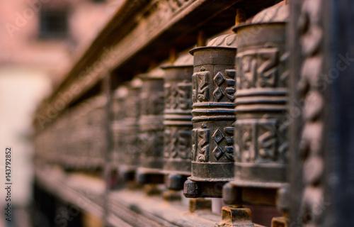Fotografie, Obraz  blurred background of buddhist praying instrument made of bronze with pali scrip
