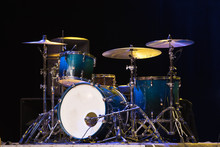 Drum Set On A Stage At Dark Background. Musical Drums Kit On Stage