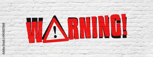 Photo  Warning on brick wall banner