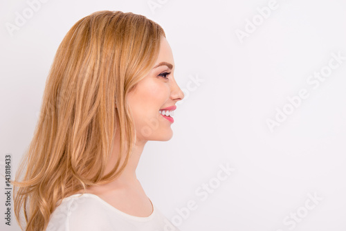 Valokuva  Side view of blonde young confident woman isolated isolated on white background