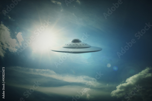 Photo sur Toile UFO UFO - Unidentified Flying Object. Alien spaceship under the sun.