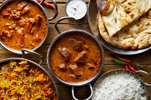 assorted indian curry and rice dishes shot from overhead composition - 143830808