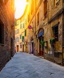 Fototapeta Uliczki - Medieval narrow street in Siena, Tuscany, Italy