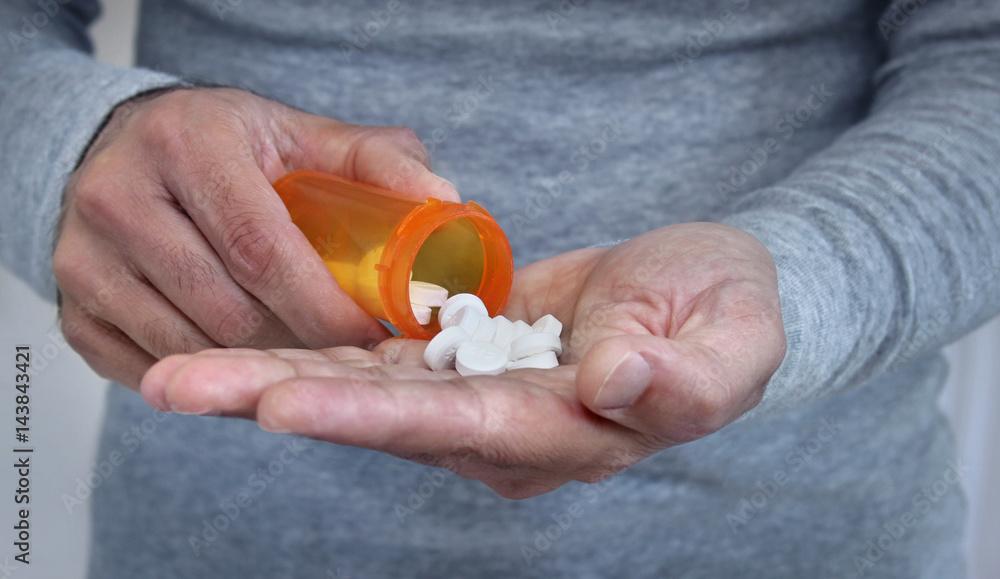Fototapeta Man taking pills