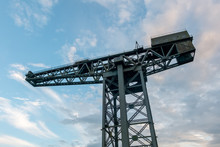 Large Crane With Blue Cloudy Sky