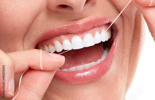 woman smile with tooth floss #143855635