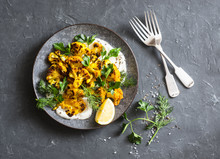 Roasted Turmeric Cauliflower With Greek Yogurt Dressing. Delicious Healthy Snack On A Dark Background, Top View