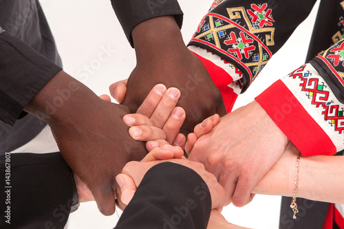 Photo People hold hands. The concept of uniting different people.
