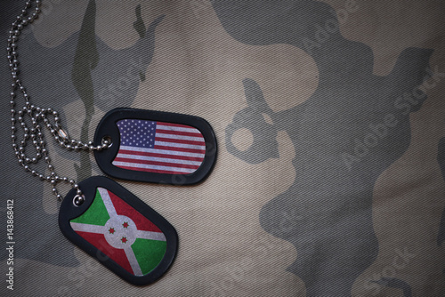 army blank, dog tag with flag of united states of america and burundi on the khaki texture background Tablou Canvas