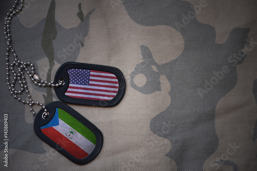 Fotografie, Tablou  army blank, dog tag with flag of united states of america and equatorial guinea on the khaki texture background