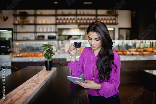Fotobehang Restaurant Woman using digital tablet at restaurant.