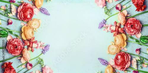 Keuken foto achterwand Bloemen Pretty floral banner with various colorful garden flowers on blue turquoise shabby chic background, top view