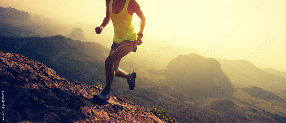Fototapety, obrazy: Young fitness woman trail runner running at mountain top