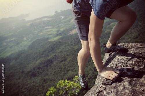 Fotografie, Obraz  success young woman rock climber on mountain peak