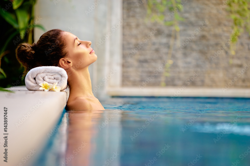 Fototapeta Beauty and body care. Sensual young woman relaxing in outdoor spa swimming pool.