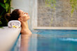 Leinwandbild Motiv Beauty and body care. Sensual young woman relaxing in outdoor spa swimming pool.