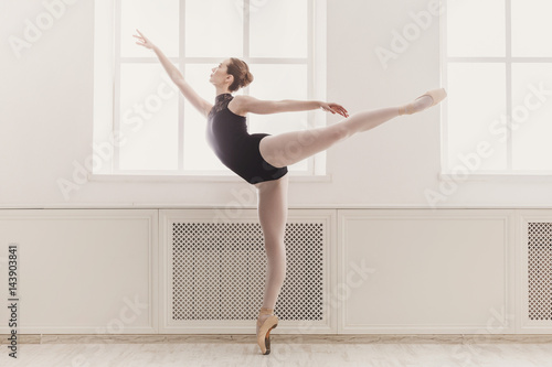 Beautiful ballerina in arabesque ballet position