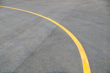 Yellow Curve Traffic Line On Road Floor Texture And Background