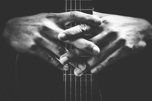 Musician Hands On Guitar Neck. Black And White, Music Background