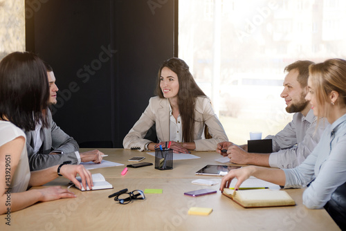 Fotografie, Obraz  Group of five people in the office at a meeting table