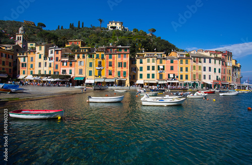 Spoed Fotobehang Amsterdam PORTOFINO, ITALY, APRIL 8, 2017 - Panoramic view of Portofino, an Italian fishing village, Genoa province, Italy. A tourist place with a picturesque harbour and colorful houses