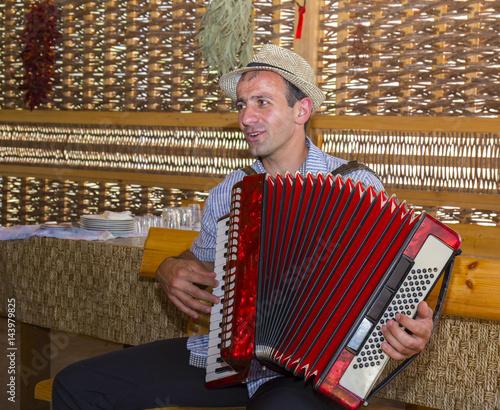 Man playing accordion Tapéta, Fotótapéta