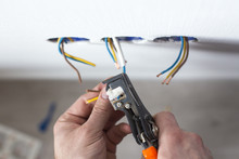 Electrician Stripping Insulation From Wire For Installation An Electrical Outlet