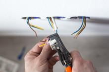 Electrician Stripping Insulati...