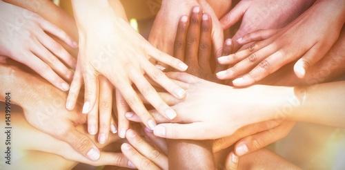 Fotografie, Obraz  Friends putting their hands together