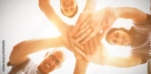 Fotografia, Obraz  Happy volunteers stacking hands together