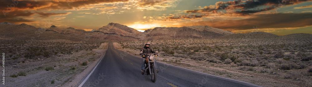 Fototapeta Biker On the road below beautiful sky