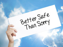 Better Safe Than Sorry Sign On White Paper. Man Hand Holding Paper With Text. Isolated On Sky Background