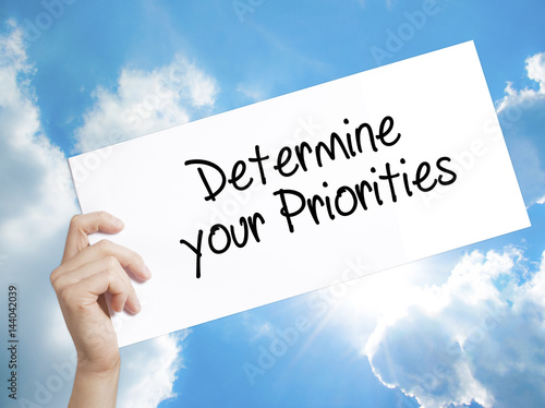 Photo Determine your Priorities Sign on white paper