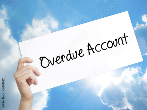 overdue account sign on white paper man hand holding paper with text isolated on