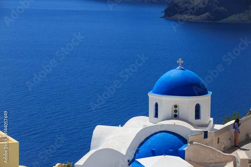 Papiers peints Santorini Santorini island in Greece - White church on blue background
