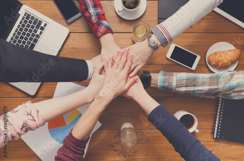 Photo  Teamwork and teambuilding concept in office, people connect hands