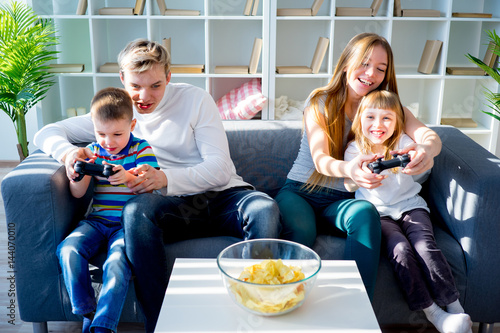 Family playing video games Canvas Print